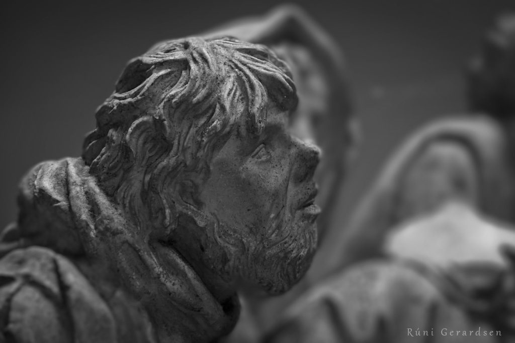 Close-up on the head of a sheperd of a sculpture of the Nativity of Jesus