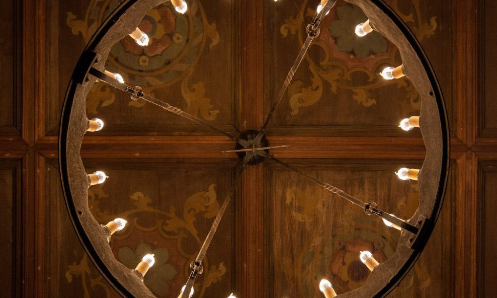 A ceiling light and painted wooden ceiling